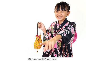 japanese girl wearing yukata - Smiling japanese girl wearing...