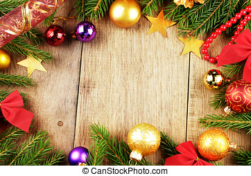 Christmas background with balls and decorations over wooden...