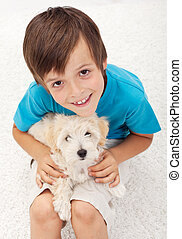Young boy with his doggy