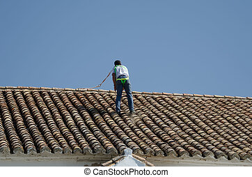 the worker on the roof