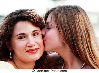 Mother and teenage daughter outside