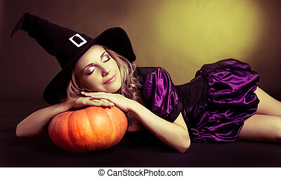 sleeping witch - beautiful sleeping witch with a pumpkin,...
