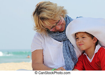 happy grandma and grandson on vacation at sea