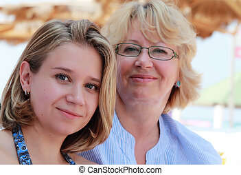 Mother and daughter on vacation at sea