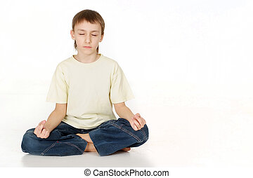 Caucasian teenager sitting meditating