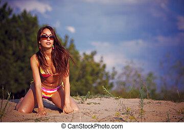 Beautiful girl in a bikini.