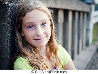 close up of pretty blue eyed teen girl