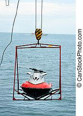 jet ski lift for dry storage on the sea background