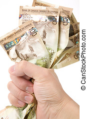 a hand full of canadian dollars, financial concept