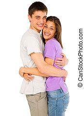 couple of teenagers embracing