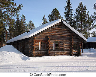 Lapland log cabin - Romantic snow covered log cabin between...