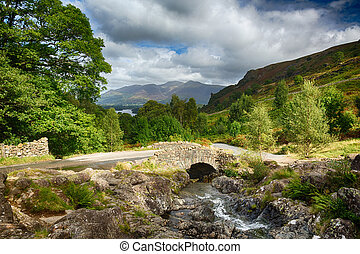 Ashness Bridge over small stream in Lake District -...