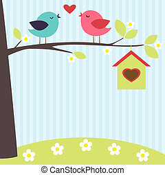 Birds in love on the blooming tree in spring