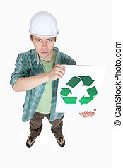 Man holding recycle logo