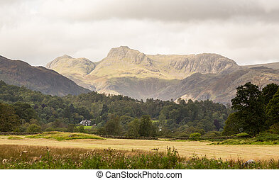Langdale Pikes in Lake District - Sun illuminating Langdale...