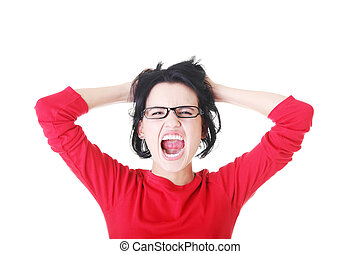 Stress. - Woman stressed is going crazy pulling her hair in...