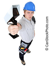 Electrician holding security camera