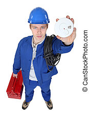 portrait of young electrician holding alarm