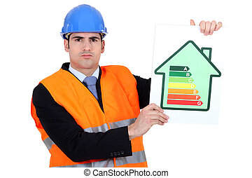 Surveyor holding energy rating poster