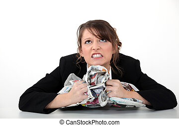 Angry woman clutching papers
