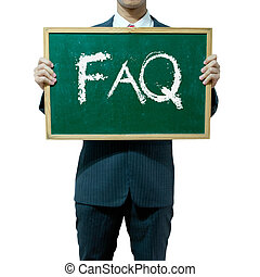 Business man holding blackboard on the background , FAQ