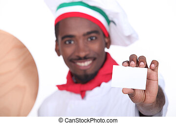 pizza chef holding a business card