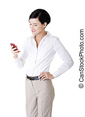 Smart young businesswoman using a smartphone - Smart happy...