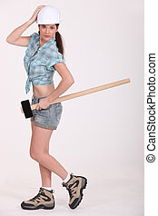 Female construction worker holding a sledgehammer.