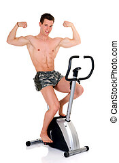 Body Builder, fitness bike - Young attractive male body...
