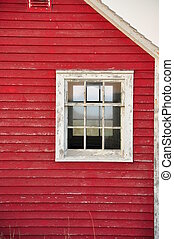 window on red building