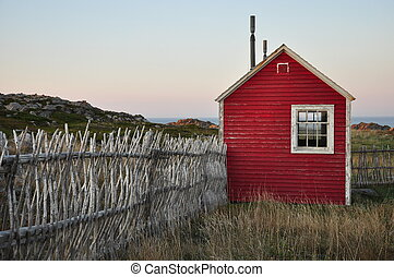 little red shed with fence