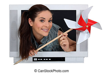 Woman coming out of the television