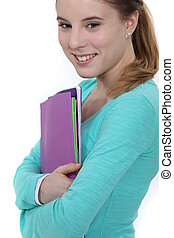 Young female student carrying folders