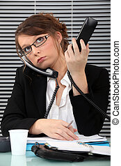 Secretary overwhelmed with two phones