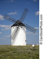 white mill on the country of la mancha in spain