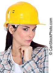 Female builder posing