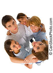 group of teenagers in huddle