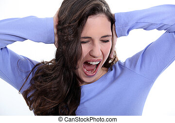 young woman plugging her ears and screaming