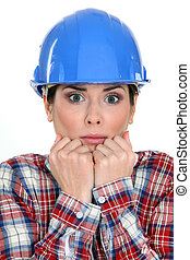 Scared female construction worker