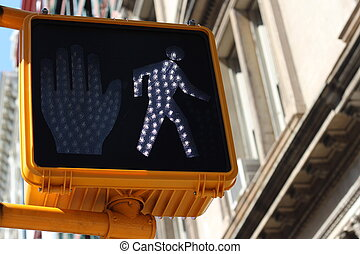 Green pedestrian signal with a little walking man indicating...