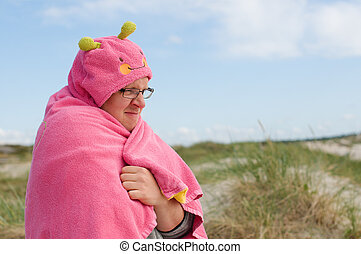 Freezing man with pink towel