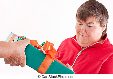 disabled woman receives gift from senior