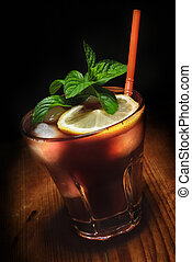 Cuba Libre cocktail on rustic wooden background