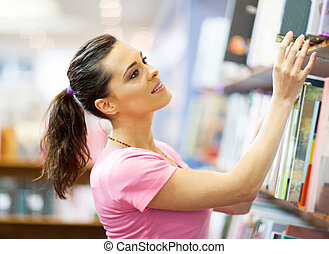 young woman searching for a book