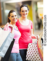 two lady friends shopping in mall