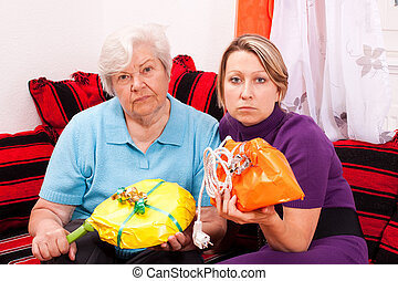 old and young woman getting improper gifts - old and young...