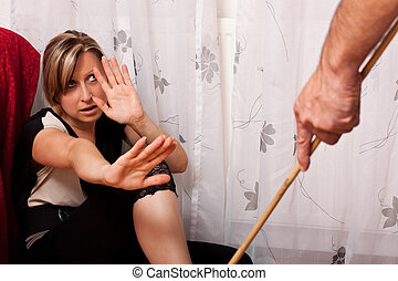 Young woman is a victim of domestic violence - Blonde woman...