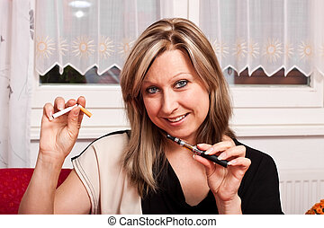 Young woman opts for electronic cigarette - Blonde pretty...