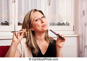 blonde woman opts for electronic cigarette - Pretty woman...