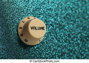 Glam rock guitar volume control - The volume knob on a...